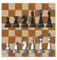 chess pieces on wooden chess board vector image