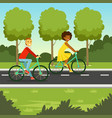 young man and woman riding bicycle in park vector image