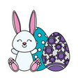 cute rabbit with easter eggs painted vector image