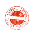 latvia sign vintage grunge imprint with flag on vector image