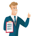 groom holding clipboard and giving thumb up vector image vector image