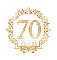 Golden emblem of seventieth years anniversary in vector image