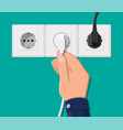 electrical outlet and hand with plug vector image