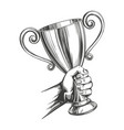 award strong hand holding a cup trophy hand drawn vector image
