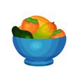blue ceramic bowl full of fresh fruits ripe mango vector image