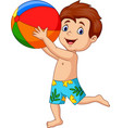 cartoon happy boy holding beach ball vector image vector image
