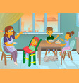 nanny in the kitchen is feeding the child and vector image vector image