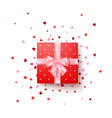 realistic red gift box with pink silk bow vector image