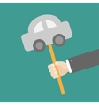 Businessman hand holding paper car on the stick vector image vector image