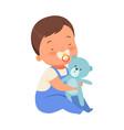 boy with toy teddy bears is sitting