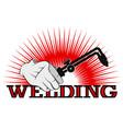 welding machine in hand symbol for business vector image vector image