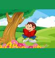 monkey reading book in garden vector image vector image