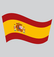 flag of spain waving on gray background vector image vector image