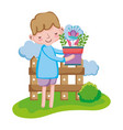 boy lifting houseplant with fence in the landscape vector image vector image