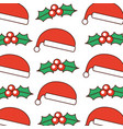 christmas hat and holly berry leaves nature vector image