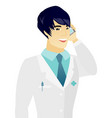 young asian doctor talking on a mobile phone vector image vector image
