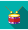 Children s toy drum on blue-green background vector image vector image