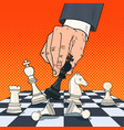 pop art hand of businessman holding chess figure vector image vector image