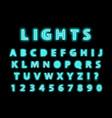 modern trendy blue neon alphabet on a black vector image