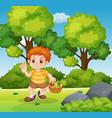 a boy holding vegetable basket in park vector image vector image