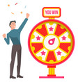 win and fortune wheel man winner and confetti vector image vector image