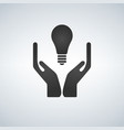 two hands holding light bulb vector image