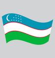 flag of uzbekistan waving on gray background vector image vector image