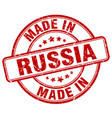 made in russia red grunge round stamp vector image vector image