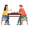 mother and daughter playing a board game together vector image vector image