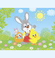 bunny and chick with an easter basket vector image vector image