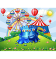 Two monsters at the hilltop with an amusement park vector image vector image