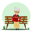 elderly woman reads the bible while sitting on a vector image vector image