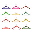 wooden clothes hangers different clothes vector image
