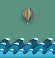blue origami paper waves with hot air balloon vector image vector image