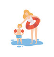 mother and her son standing in water boy wearing vector image vector image