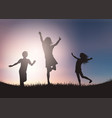silhouettes children playing against sunset sky vector image vector image