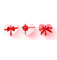 set heart-shaped gift boxes with red bow vector image