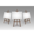 Set of Brown Wooden Easels with Blank Canvases vector image vector image