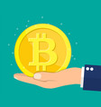 golden coin with bitcoin sign in hand vector image