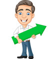 cartoon young businessman holding a green arrow vector image vector image