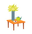 flower and teapot with plate on table set vector image vector image