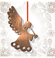 Wooden figure of angel vector image