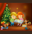 christmas miracle - kids reading the book beside a vector image vector image