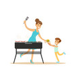 mother with her son preparing sausages and burgers vector image vector image