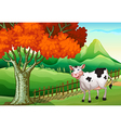 A smiling cow near the big tree vector image vector image