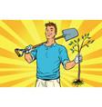 man gardener with a shovel and sapling vector image
