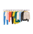 colored clothes or apparel hanging on hangers on vector image
