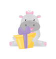 cute adorable hippo with a pink bow sitting and vector image vector image