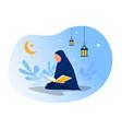 man is reading al quran on night ramadan day