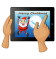 A finger touching a gadget with a smiling Santa vector image vector image